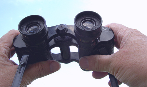 A man holding a pair of binoculars