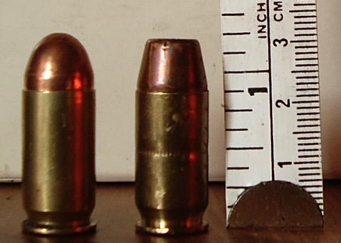 .45 caliber ACP ammunition. Left standard FMJ; right wadcutter.