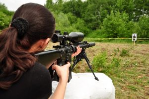 A woman shooting a target