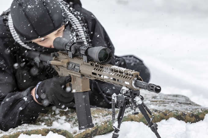 A shooter shooting in snow
